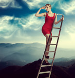 elegant woman on a ladder