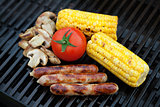 Grill bbq sausages and vegetables