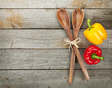 Colorful bell peppers and kitchen utensils