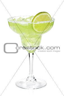 Classic margarita cocktail with lime slice and salty rim
