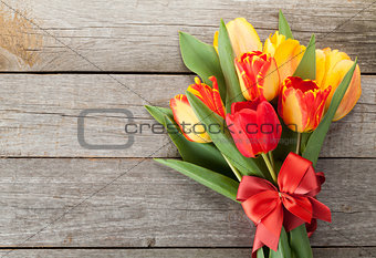 Fresh colorful tulips with ribbon and bow