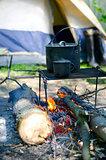 Tourist boiler mug and heated over a fire of wood