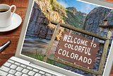 Colorado welcome sign on laptop