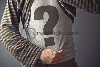 Casual man showing question mark printed on his shirt