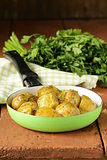 tasty baked potatoes with herbs in the pan
