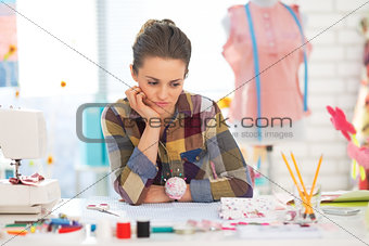 Portrait of concerned seamstress in studio