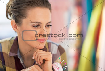 Portrait of thoughtful seamstress