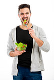 Young man eating a salad