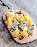Pieces of emmental and blue cheese