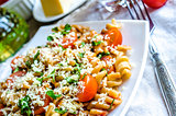 Whole heat fusilli pasta with cheese and cherry tomatoes