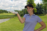 Female golfer holding a golf ball in her hand