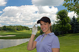 Woman golfer holding a golf ball in her hand