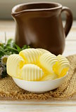 fresh yellow dairy butter in a white bowl