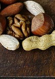 Mix nuts on a wooden background macro shot