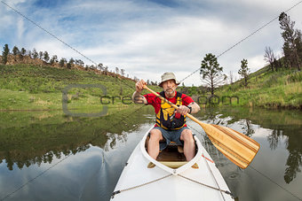 senior athletic canoe paddler