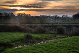 Dwn over railway tracks through countryside landscape
