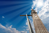 Cross and Belfry on Blue Sky