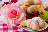 Breakfast croissant and coffee - brioches