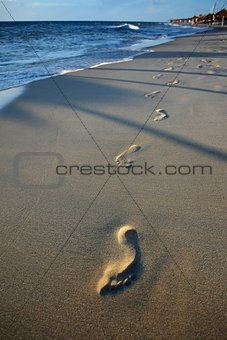 Footprints in sand beach