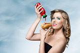 woman with ketchup and hot-dog