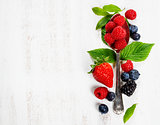 Berries with spoon  on Wooden Background. Health, Diet, Gardenin