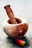 Wooden Mortar and Pestle and chilli peppers