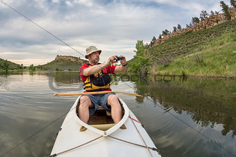 canoe paddler photographing