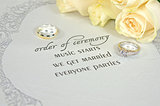 wedding ring on contemporary invitation