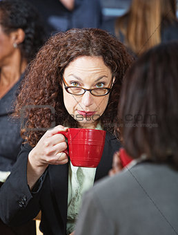 Serious Businesswoman with Cup