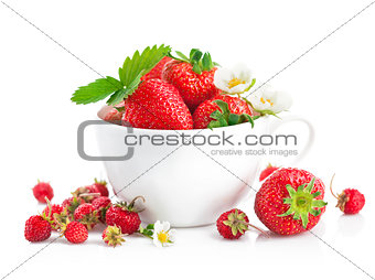 Fresh strawberry in cup with green leaf and flower