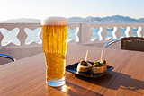 Glass of beer near the sea.