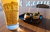 Small green peppers bites with beer.