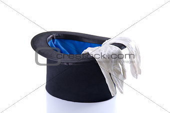 Black top hat with a pair of white gloves