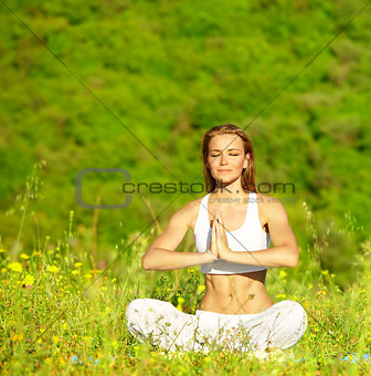 Healthy female doing yoga