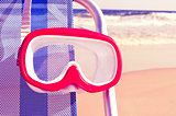 diving mask hanging in a deckchair with a retro filter effect