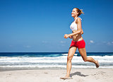 Healthy woman running on the beach