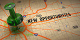 New Opportunities - Green Pushpin on a Map Background.