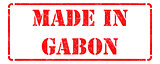 Made in Gabon- inscription on Red Rubber Stamp.