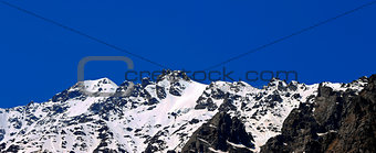 Caucasus mountains under snow and clear blue sky