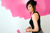 Sensual Beautiful Woman Works on Project to Paint the Walls Pink