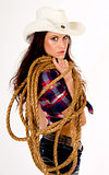 Hero Cowgirl White Hat Looks over Her Shoulder Holding Lasso