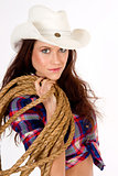 Beautiful Cowgirl Smiles in White Cowboy Hat Holding Rope