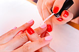 Skin and nail care. Applying of the Transparent varnish.