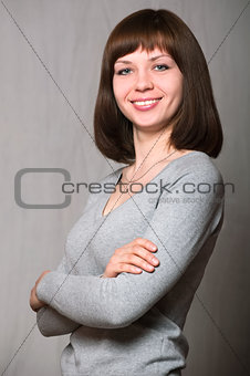 Attractive woman with her arms crossed