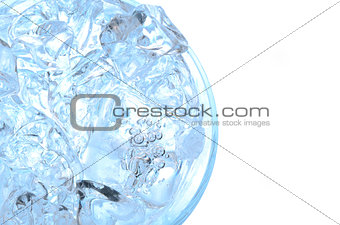 Water with ice in a glass, above view