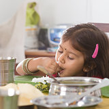 Indian girl eating rice