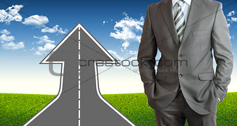 Businessman and road climbs up