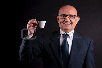 old businessman with a cup of coffee