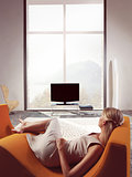 Blond woman watching TV