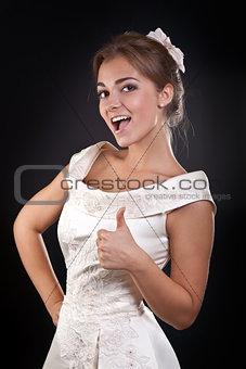 Beautiful girl in dress shows OK in the studio